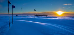 The National Science Foundation's Atmospheric Research Observatory illuminated by the sun approaching South Pole sunset in 2014. (NOAA-LT Joseph Phillips)